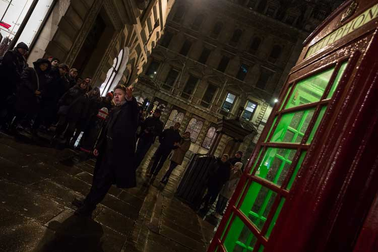 Richard Jones alongside a haunted phone box.